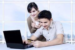 Asian couple online shopping Stock Photos