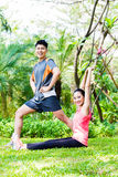 Asian couple at outdoor fitness training Royalty Free Stock Photos