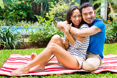 Asian couple outdoor in the garden Royalty Free Stock Photo