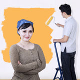 Asian couple paint wall in yellow color Stock Photography