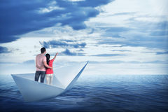Asian couple on the paper boat Royalty Free Stock Photos
