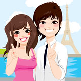 Asian Couple Paris Honeymoon. Young Asian couple enjoying honeymoon in Paris with Eiffel Tower in background Royalty Free Stock Image