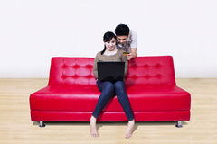 Asian couple pay online using credit card at home Stock Photos