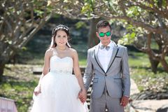Asian couple photographed before marriage is Pre-wedding on Koh. Si Chang Island Popular locations in the Chonburi province at Thailand Stock Photos