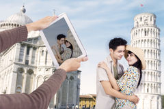 Asian couple at Pisa Tower Italy Stock Photos