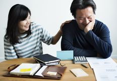Asian couple planning for the investment Royalty Free Stock Photo