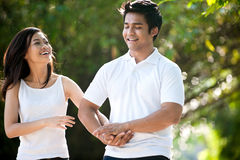 Asian Couple Playing in the Park Stock Photography