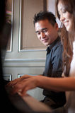Asian Couple Playing Piano Stock Photography