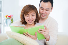 Asian couple reading book Stock Photo