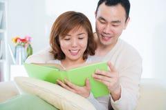 Asian couple reading book Stock Photo