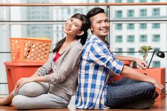 Asian couple after relocation to new apartment Royalty Free Stock Images