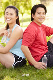 Asian couple resting after exercise Royalty Free Stock Photos