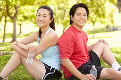 Asian couple resting after exercise Stock Photos