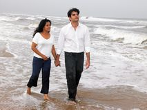 Asian couple at the sea shore royalty free stock photo