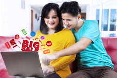 Asian couple searching big sale offer Stock Photo