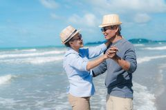 Free Asian Couple Senior Elder Retirement Resting Relax Dancing At Sunset Beach Stock Images - 159732894