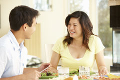 Asian couple sharing meal at home Stock Photo