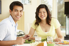 Asian couple sharing meal at home Royalty Free Stock Images