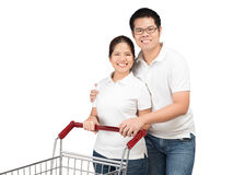 Asian couple with shopping cart Royalty Free Stock Image