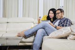 Asian couple shopping online at home Stock Photos