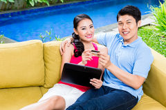 Asian couple shopping online in internet with laptop Royalty Free Stock Image