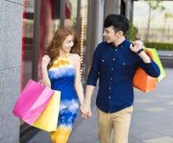 Asian couple shopping in urban street. Happy asian couple shopping in urban street stock photos