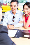 Asian Couple signing sales contract for car Royalty Free Stock Photos