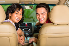 Asian couple sitting in car Stock Photo