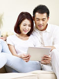 Asian couple using digital tablet together royalty free stock images