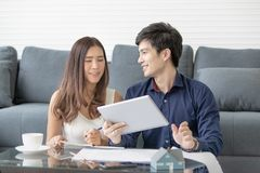 Asian couple smile happily is planning to build his home in the royalty free stock photography