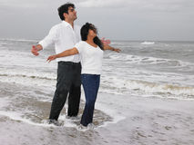 Asian couple standing in the beach Stock Photos