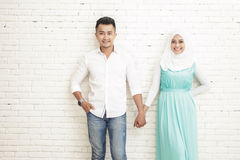 asian couple standing and smiling while holding each other hands Stock Photo