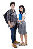 Asian couple students isolated Royalty Free Stock Photography