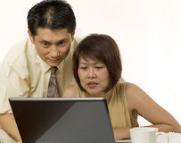 Asian couple surfing the internet Stock Photography