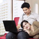 Asian couple surfing internet at home 1 Royalty Free Stock Photo