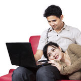 Asian couple surfing internet at home 2 Stock Images