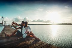 Asian couple taking a selfie Royalty Free Stock Photography