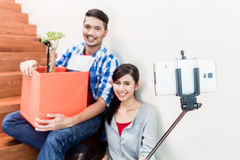 Asian couple taking selfie from their moving day Stock Image