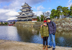 Asian couple tourist embracing at Matsumoto Castle Royalty Free Stock Photography