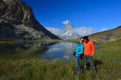 Asian couple traveler smiling  in front of Riffelsee lake and Ma Stock Images