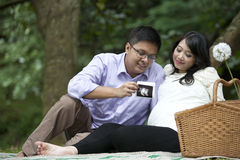 Asian couple with ultrasound printout Royalty Free Stock Photos
