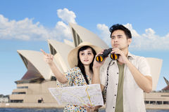 Asian couple using binoculars in Sydney, Australia Royalty Free Stock Images