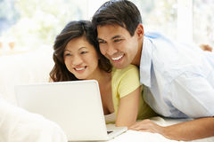 Asian couple using laptop at home Royalty Free Stock Images