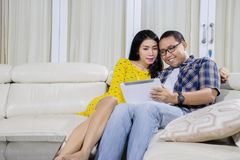 Asian couple using tablet together at home Royalty Free Stock Image