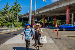 Asian couple walking in Chinatown Seattle Washington Royalty Free Stock Images