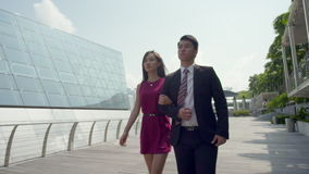 Asian couple walking hand in hand in slow motion stock video