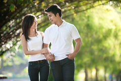 Asian Couple Walking in a park Stock Photos