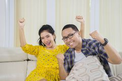 Asian couple watching basketball match at home Royalty Free Stock Images