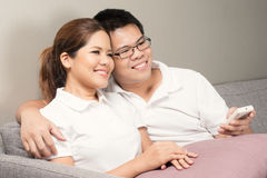 Asian couple watching tv Royalty Free Stock Image