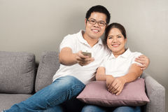 Asian couple watching tv Stock Images